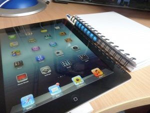 ipad with apps and notebook