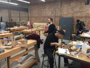 Students in a hands-on, shop building class.